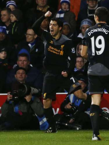 Suarez's brace kept him among the leading scorers in the EPL. REUTERS/Eddie Keogh