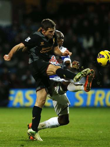 Liverpool's Joe Allen (L) challenges Queens Park Rangers' Stephane Mbia . REUTERS/Eddie Keogh