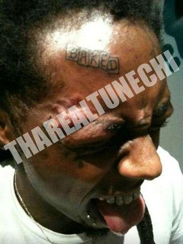 JANUARY 3 - Lil Wayne got super stoked on a trip to the Baker Skateboards HQ and got this ridiculous 'Baked' tattoo on his forehead. We get it, Tunech, you love skateboarding.