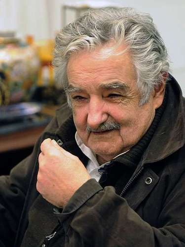 Mujica only requires for his security a couple of policemen in casual dress who watch him from a car parked outside his home on a street that is not paved, according to daily La Nación.