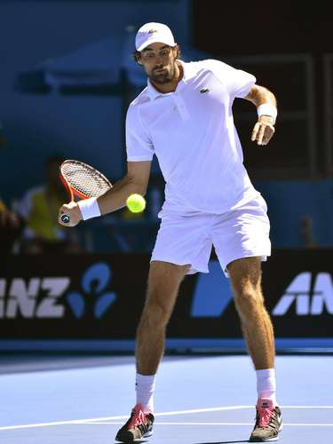 Jeremy Chardy of France hits a return to Juan Martin del Potro of Argentina during their men's singles match at the Australian Open tennis tournament in Melbourne January 19, 2013. REUTERS/Toby Melville (AUSTRALIA - Tags: SPORT TENNIS)