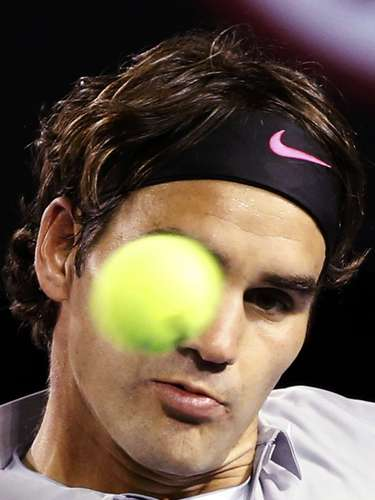 Federer watches the ball during his men's singles match. REUTERS/Daniel Munoz