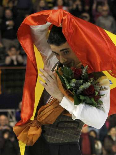 Gold medallist Javier Fernandez of Spain holds his national flag during the award ceremony for the men's skating at the European Figure Skating Championships in Zagreb January 26, 2013.    REUTERS/Antonio Bronic (CROATIA  - Tags: SPORT FIGURE SKATING)