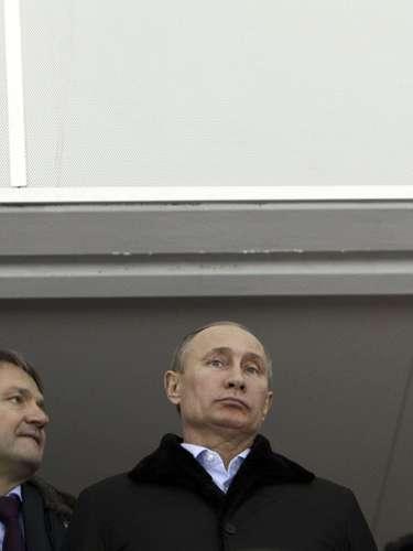 Russian President Vladimir Putin (C), flanked by Vice Premier Dmitry Kozak (L) and Krasnodar region Governor Alexander Tkachev, visits the Speed Skating center Adler Arena.