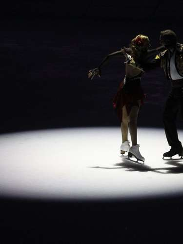 Ice skaters perform during a ceremony to launch a countdown clock for the 2014 Winter Olympics.