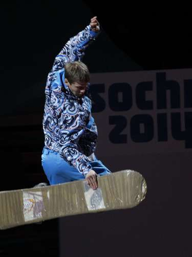 A snowboarder performs during a ceremony to launch a countdown clock for the 2014 Winter Olympics in the Bolshoi Ice Dome.