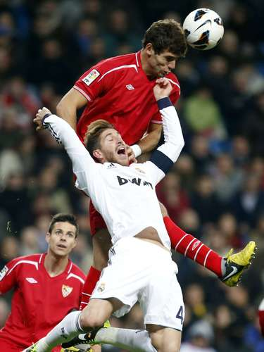 Real Madrid's Sergio Ramos (bottom) and Sevilla's Federico Fazio challenge for the ball.