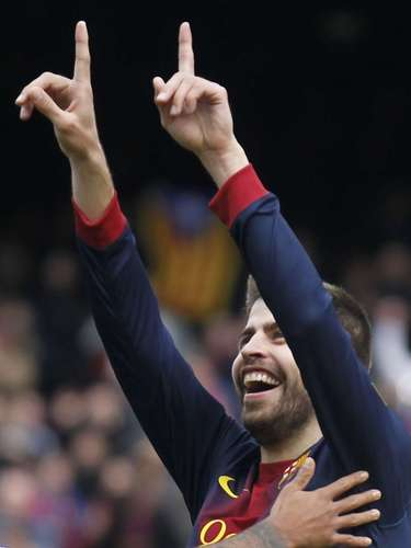 Barcelona's Gerard Pique celebrates after scoring.