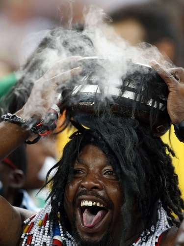 A Nigerian soccer fan cheers ahead of the African Nations Cup final.