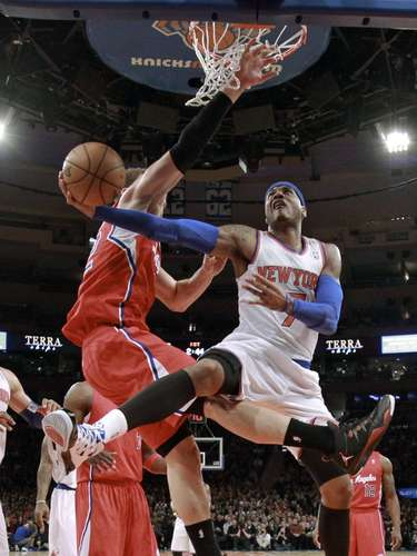 New York Knicks forward Carmelo Anthony (7) drives to the basket against Los Angeles Clippers forward Blake Griffin in the first quarter of their NBA basketball game at Madison Square Garden in New York, February 10, 2013.