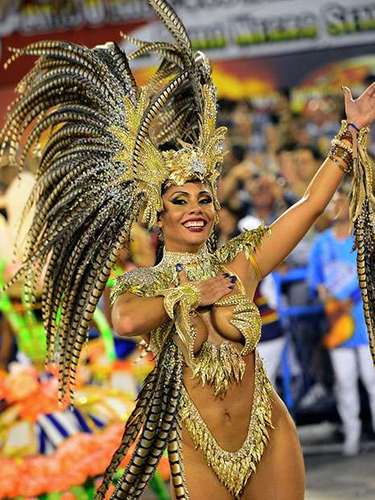 The deafening thumps of parading percusionists, enormous floats and scantily clad dancers from six renowned schools took part in the celebration Monday night. Another six, among them defending champion Unidos da Tijuca, paraded on Sunday. The winners will be revealed in upcoming days.