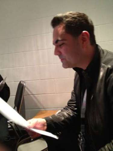 Enrique Santos reads the script to prepare for the big night.