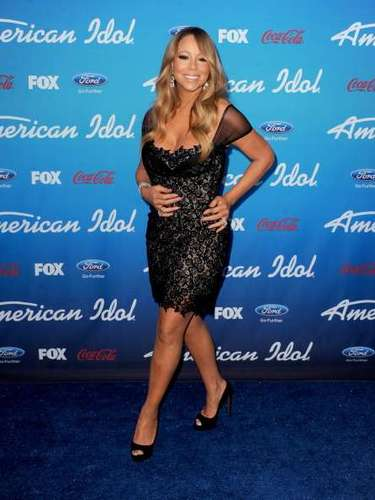 Mariah Carey. Esta cantante gusta de presumir sus prominentes curvas con vestidos entallados y esta vez no fue la excepción con este sensual atuendo en encaje y escote desbordante
