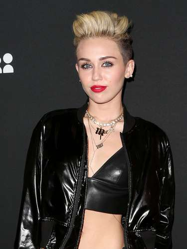 Miley Cyrus looks bad ass arriving at the MySpace launch party in LA Wednesday night (June 12). With a stunning red lips, bare abs, leather jacket, boyfriend jeans and her blonde coif, she owned the red carpet!