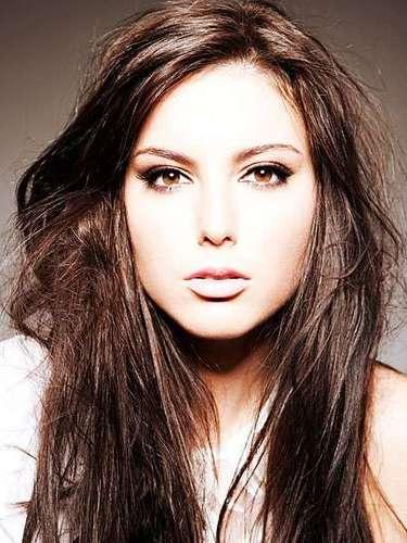 Y del otro lado del mundo viene Miss Australia, Olivia Wells. Tiene 19 años de edad y reside en Black Rock.