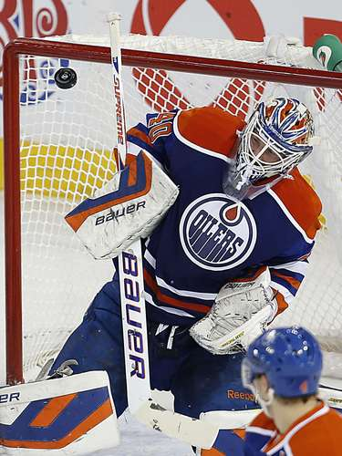 Dec 12, 2013; Edmonton, Alberta, CAN; Edmonton Oilers goaltender Devan Dubnyk (40) makes a save against the Boston Bruins during the first period at Rexall Place. Mandatory Credit: Perry Nelson-USA TODAY Sports