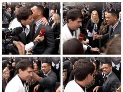 """Esta serie de fotografías, tomada de un video de la AP, muestra el momento en que el actor estadounidense Wil Smith recibe un abrazo del reportero Vitali Sediuk y lo abofetea después de que el periodista trató de besarlo, el viernes 18 de mayo de 2012, antes del estreno de """"Men in Black III"""", en Moscú   Foto: ia AP video / AP"""