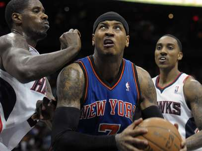 Carmelo Anthony says it's up to the Knicks as to whether to re-sign Jeemy Lin or not. Foto: AP in English