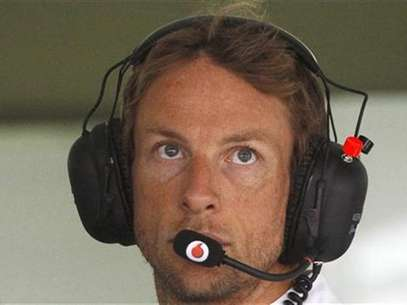 El piloto de McLaren Jenson Button durante la segunda sesión de ensayos del Gran Premio de Alemania en Hockenheim, jul 20 2012. El piloto británico Jenson Button fue el más rápido el viernes en las prácticas libres para el Gran Premio de Alemania de la Fórmula Uno y su compañero Lewis Hamilton quedó segundo, dando a McLaren el dominio en el circuito de Hockenheim donde Michael Schumacher salió ileso tras un vergonzoso choque. Foto: Ralph Orlowski / Reuters en español