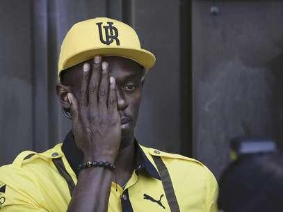 El velocista jamaicano Usain Bolt posa para un fotógrafo tras una conferencia de prensa el jueves, 26 de julio de 2012, en la antesala de los Juegos Olímpicos de Londres.  Foto: Ben Curtis / AP