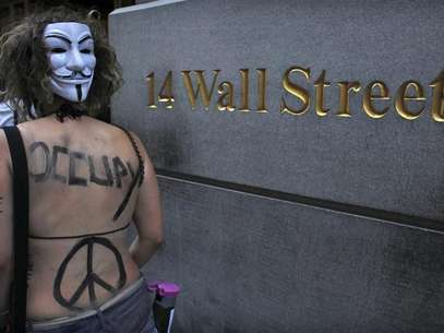 An Occupy Wall Street activist takes part in a march in downtown Manhattan in New York July 11, 2012. Foto: Eduardo Munoz / Reuters In English