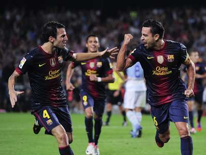 Cesc Fabregas and Xavi Hernandez celebrate the latter's goal in a 2-0 win over Granada Foto: Getty Images