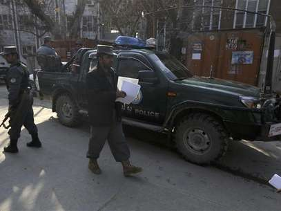 U.S. security personnel escorts a U.S. convoy to Kabul police headquarters in Kabul December 24, 2012. Foto: Mohammad Ismail / Reuters