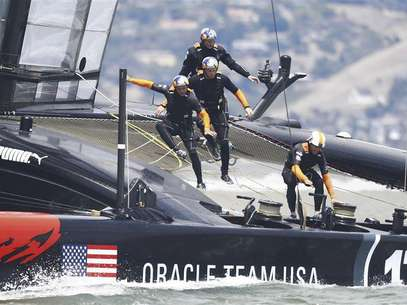 Oracle Team USA team trains on their AC72 catamaran on San Francisco