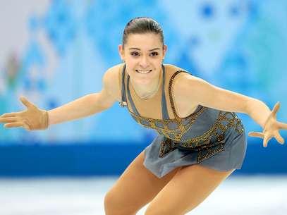La rusa Adelina Sotnikova competes en la final del patinaje artístico de los Juegos Olímpicos de Invierno, el jueves 20 de febrero de 2014, en Sochi, Rusia. Foto: Ivan Sekretarev / AP
