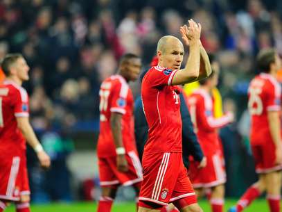 Arjen Robben (C) of Muenchen and his teammates celebrate advancing to the quarterfinal during the UEFA Champions League Round of 16 second leg match between FC Bayern Muenchen and Arsenal FC. Foto: Getty Images