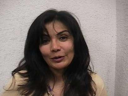 """En esta foto de archivo del 28 de septiembre de 2007 distribuida por la Procuraduría mexicana, Sandra Avila Beltrán, llamada """"La reina del Pacífico"""" sonríe tras ser arrestada por agentes federales en un restaurante de la ciudad de México. Foto: AP"""