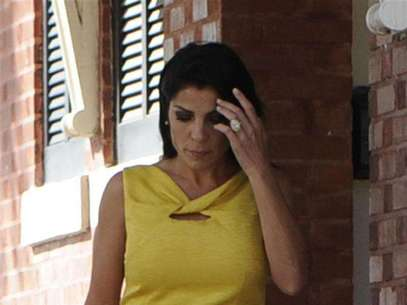 Jill Kelley, a friend of the Petraeus family, walks out of her home toward her car on Bayshore Boulevard in Tampa, Florida November 12, 2012. Foto: Brian Blanco / Reuters