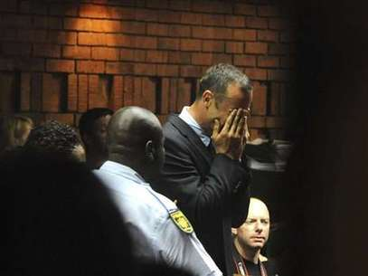 Pistorius wept in court after hearing he would be charged with premeditated murder. Foto: AP in English