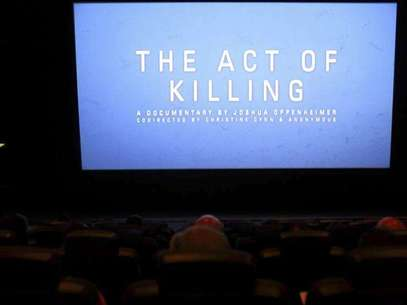 "The opening of ""The Act of Killing"", a documentary made by Texan-born director Joshua Oppenheimer, is pictured during an underground screening at a theatre in Jakarta February 6, 2013. Foto: Beawiharta / Reuters"