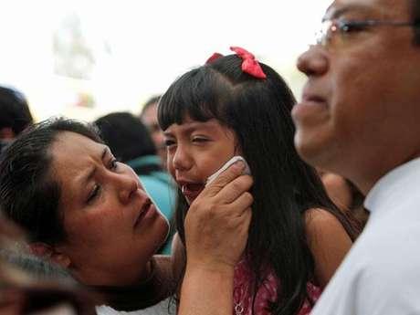Una familia de deportados llega a la Ciudad de México. Foto: AP