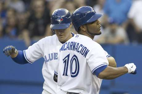 Toronto Blue Jay's Edwin Encarnacion celebrates during the win against the Rangers.  Foto: The Canadian Press, Chris Young / AP
