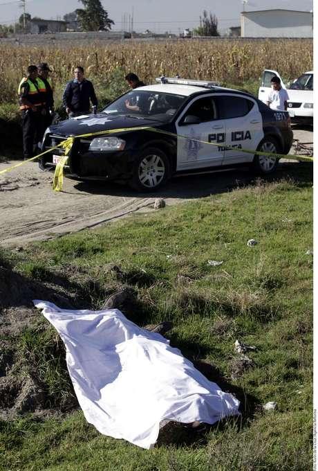 Cadáver encontrado en un solar Foto: Agencia Reforma