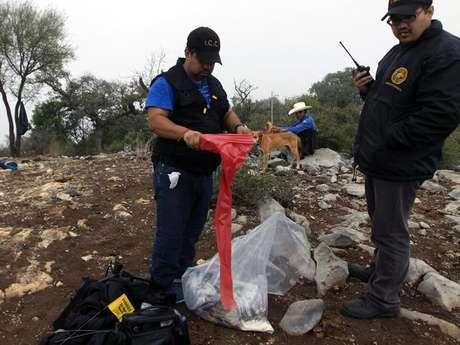 Personal del Semefo concluyó con el retiro en su totalidad de los restos de las víctimas del fatal accidente aéreo. Foto: AFP
