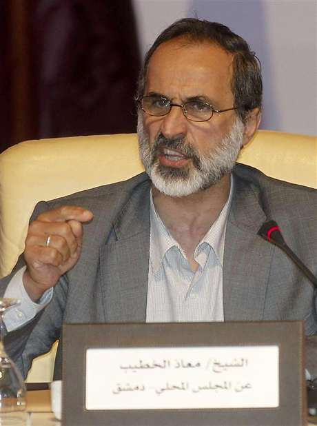 Activist preacher Mouaz al-Khatib speaks the General Assembly of the Syrian National Council in Doha November 11, 2012. Foto: Mohammed Dabbous / Reuters