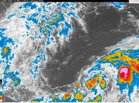 Baja presión se ubica en tierra, en los límites de Quintana Roo y Belice generando nubosidad dispersa sobre la mayor parte de la Península de Yucatán. Foto: SMN