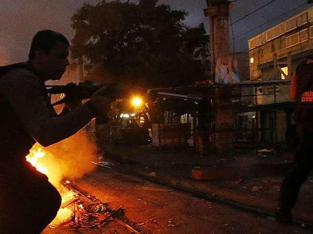 http://p1.trrsf.com/image/fget/cf/67/51/images.terra.com/2012/10/15/favela-01.JPG