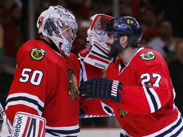 Chicago Blackhawks Johnny Oduya And Goalie Corey Crawford React